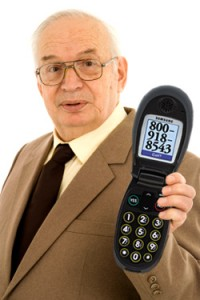 Mature businessman using his cell-phone
